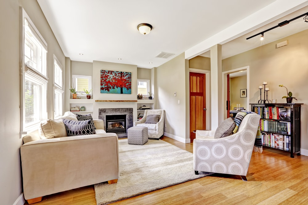 It's one of the most time-honored questions of interior decorating – how can you make a small space feel larger? It's a question that's especially pertinent for family homes and apartment living. A family home can start to feel pretty cluttered, and apartments in cities such as New York and London aren't famed for their spaciousness. How can you make these spaces feel bigger without spending a fortune? There are plenty of tips and tricks that can be used to make a space feel bigger than it really is, from lighting to the arrangement of mirrors. But what about your color scheme? How can you use paint to make your walls and rooms seem bigger than they really are? 1. Use Light Colors First and foremost, you need to fall back on the oldest trick in the decorating book when it comes to making a room seem larger, and that's using light colors. Light reflects better off of lighter surfaces than dark ones, and light is the key to making a space look and feel larger. The same holds true for mirrors – the lighter the room's paint scheme, the more you'll be able to take advantage of any mirrors' reflective abilities to make the space seem bigger. You'll, therefore, want to opt for beiges, butters, creams, eggshells, and similar light colors. 2. All in the (Color) Family One way to make a space seem larger is to make it appear unified. Having the same décor scheme from wall to wall and room to room can make everything feel like a single joined-together whole, which in turn can make everything feel much larger. You, thus, want to choose colors from the same color family. If you are going with cream, for example, and want to accent your base color, choose another cream or similar color to do so. 3. Ceiling Color Contrast One of the best ways to play around with the perspective of your room and make it feel more spacious is by painting your ceiling a different color than the rest of the space. This works especially well if you've followed the second step and have painted your walls, doors, and accented areas in the same color family. Given that backdrop, a differently-colored ceiling can appear even taller than it is, which in turn can make your room appear bigger. 4. Create an Accent Wall Another classic way of playing with perspective in painting is to direct the viewer's eyes to a single space on the canvas. The same trick can work for your home in the form of an accent wall. This wall should be a different color from the rest of the room. The idea is that if this space really stands out and is lit well enough to have the color really pop, it will direct guests' attention to that point. If that accent wall is positioned at the right point in your room (such as the back or side of your kitchen) it can make the whole space feel bigger. Make a small space feel all the bigger and bolder with these interior painting tips today.